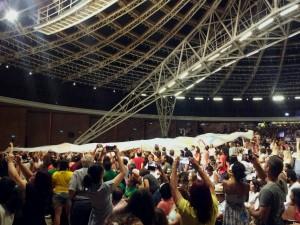 Tecido com logo da SENAES foi levantado durante fala de Paulo Singer|Foto: Fernanda Canofre/Sul21